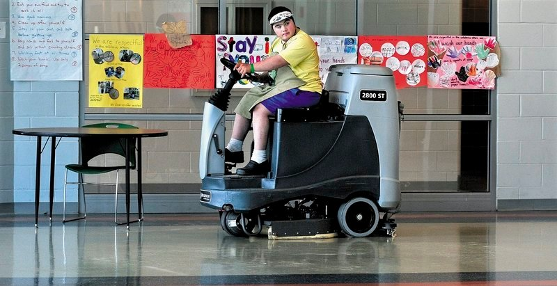 Mario Montana of Troy operates a floor cleaning machine at Mount View High School in Thorndike recently.