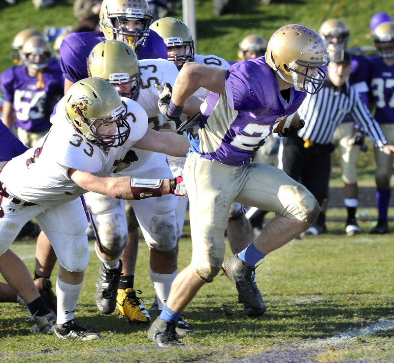 Donald Goodrich of Cheverus breaks away from John Remmes of Thornton Academy to score on a 54-yard run in the third quarter Saturday. Cheverus won, 21-10.