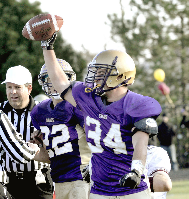 Colie Walsh of Cheverus has the ball in his grasp after recovering a fumble, and not long after the Stags had the Western Class A title in their grasp for a second season.
