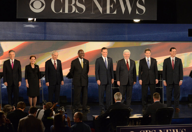 Herman Cain, from left, Mitt Romney, Newt Gingrich, and Rick Perry take the stage at Saturday's GOP debate. Jon Huntsman, Michele Bachmann and Rick Santorum also participated.