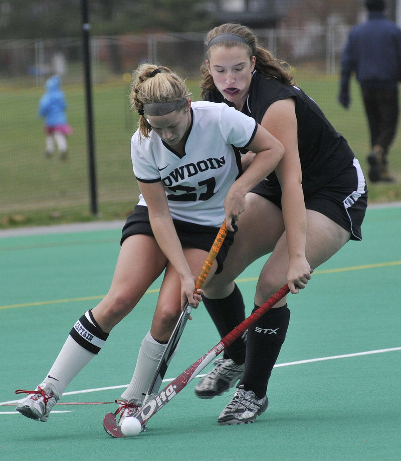 Katie Herter of Bowdoin battles for the ball Sunday in the third round of the NCAA Division III field hockey tournament against MIT. Bowdoin won, 3-0.
