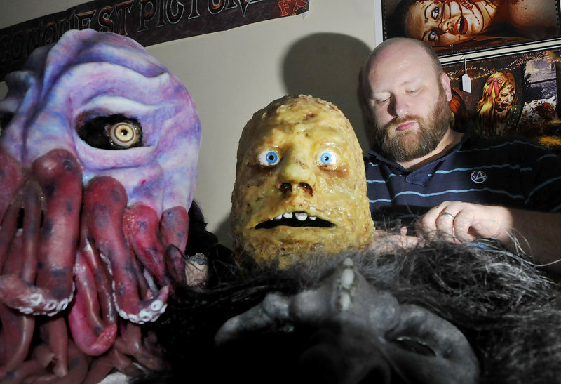 Eric Anderson of Portland, a special effects artist, works on straps for his masks at Coast City Comicon at the Eastland Park Hotel in Portland on Sunday.