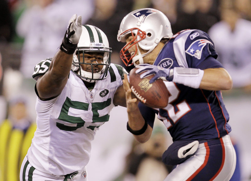 Jamaal Westerman of the Jets pressures Pats quarterback Tom Brady Sunday night in New Jersey. The Pats did most of the pressuring, however, winning 37-16.