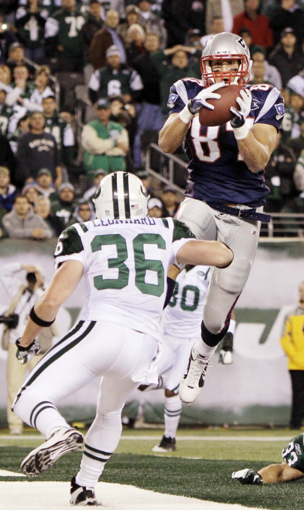 Rob Gronkowski catches a TD pass in the second quarter Sunday night in front of Jim Leonhard of the Jets. Gronkowski had eight catches for 113 yards and 2 TDs.