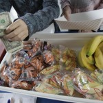 A student pays for fruits and vegetables at a school in Palo Alto, Calif. Congress wants to keep pizza and french fries in the nation's school lunch programs.