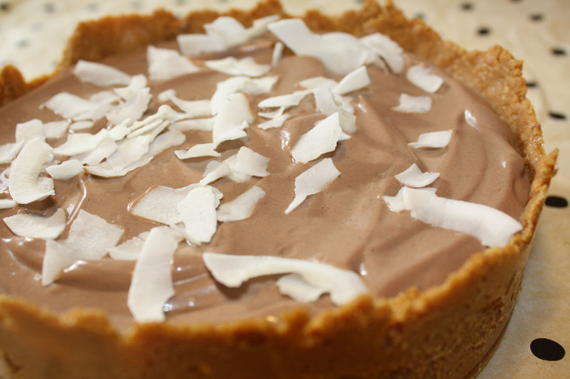 Chocolate Pudding Pie in a graham cracker crust can be topped with coconut flakes.