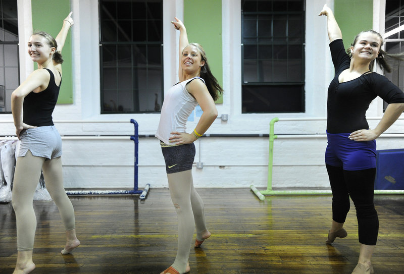 From left, Kelly Wilson, Kendra Madore and Whitney Wallace train this week at the Drouin Dance Center in Westbrook as part of a team of six local performers who will participate in the iconic Macy's Thanksgiving Day Parade in New York City next week.