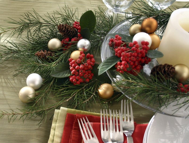 A festive table setting styled by Zelda Gordon. Piney greens can enhance your decor – and give off their fresh scent – all winter long.