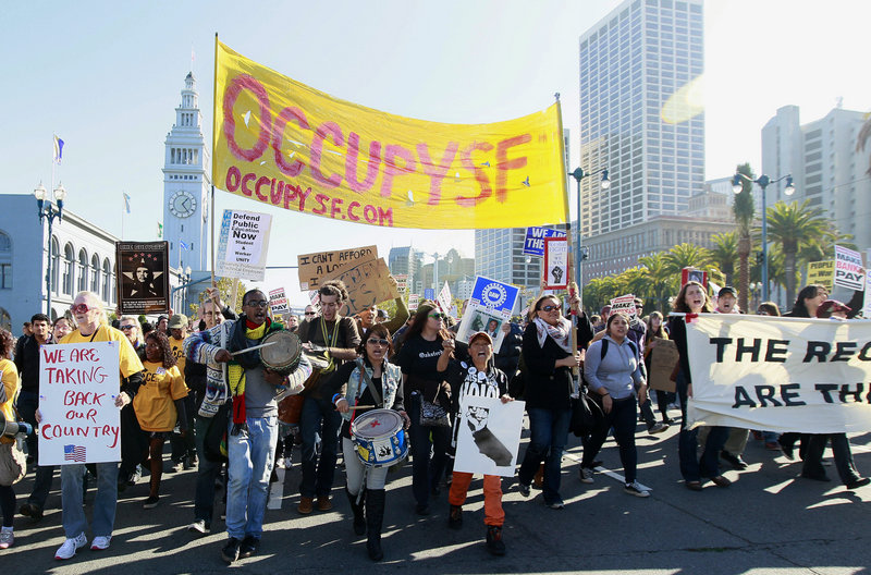Occupy protesters march along the Embarcadero as part of a demonstration in San Francisco on Wednesday.