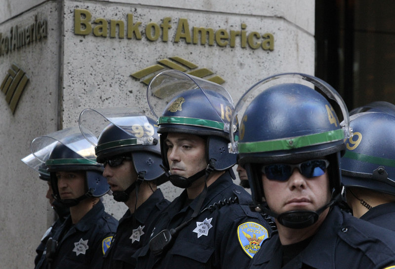 San Francisco police wait outside a Bank of America branch after more than 100 protesters stormed into the office on Wednesday. Police arrested a number of protesters.