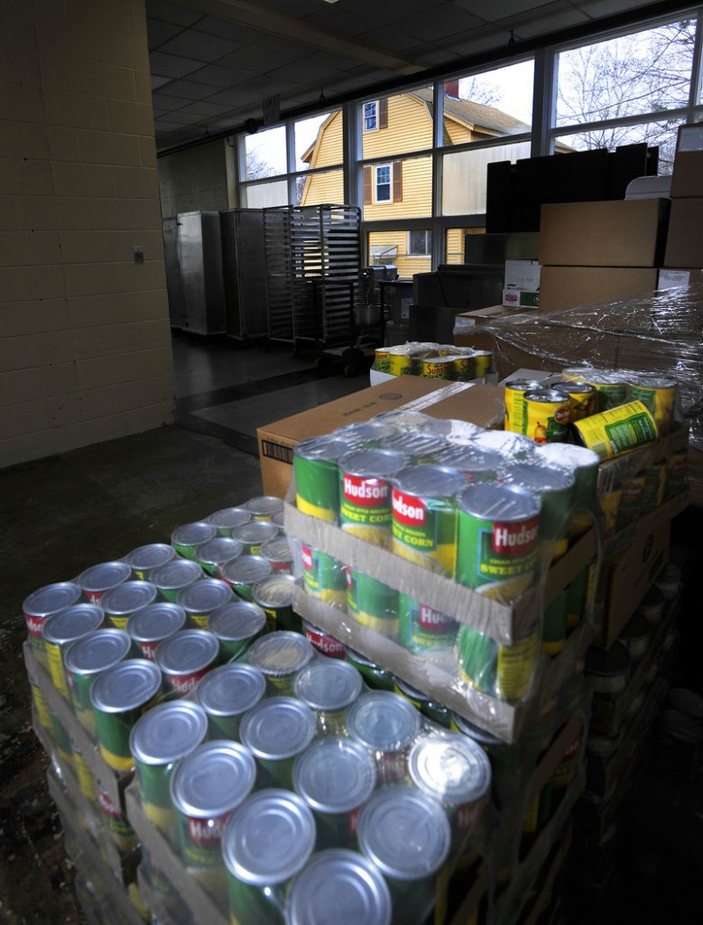 Cans of food are stacked at the Portland School Department's central kitchen. School officials are looking into either renovating the current facility or building a new one near the PATHS school on Allen Avenue.