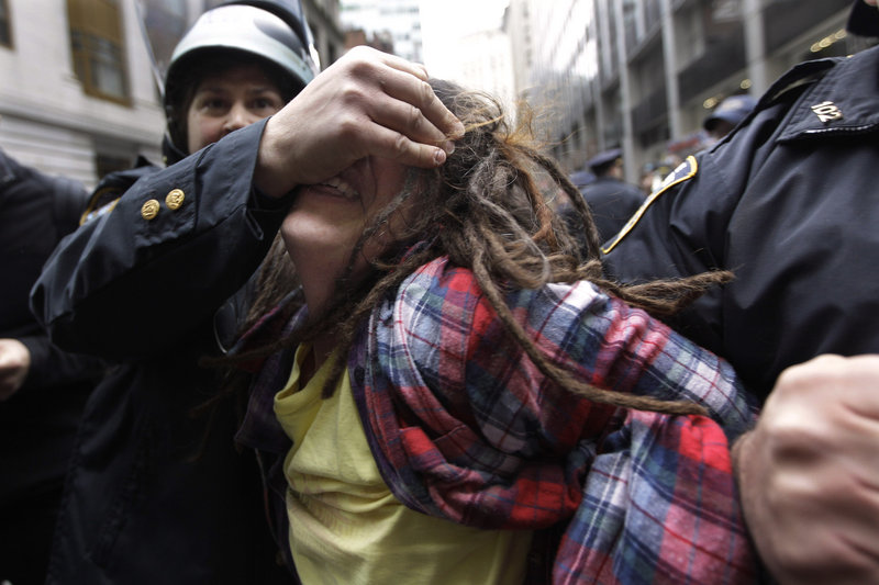 Police officers arrest a demonstrator affiliated with the Occupy Wall Street movement Thursday in New York.