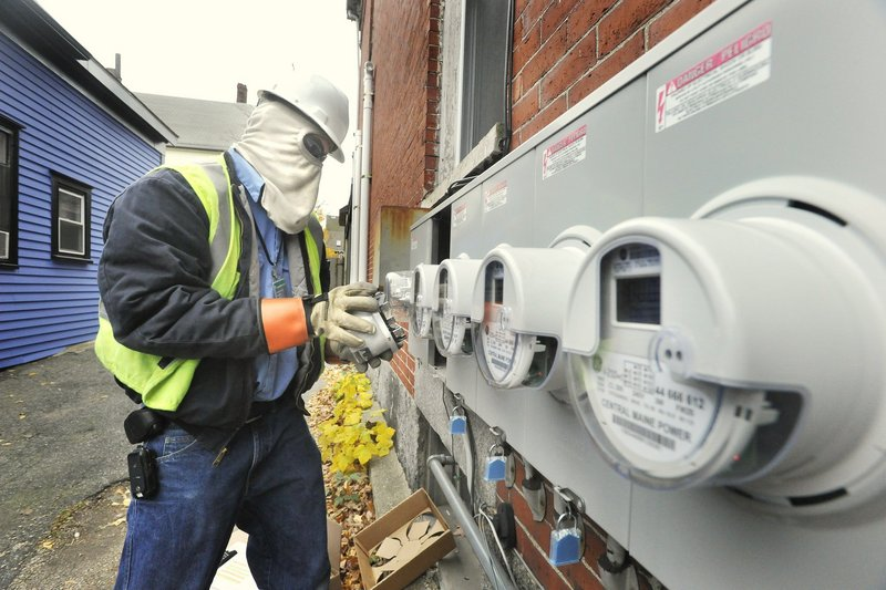 A spokesman for Central Maine Power says the company is aware of the problem with its smart meters, seen being installed last year in Portland, and has set up a special unit to handle complaints.
