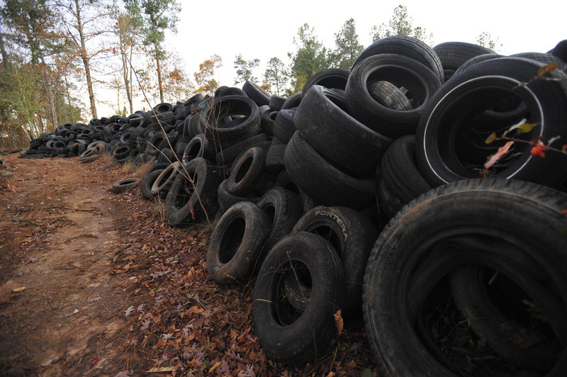 Dumped tires are piled near Elloree, S.C. The tires started piling up on county land in South Carolina, growing to a mound of about 1 million tires covering several acres of land.