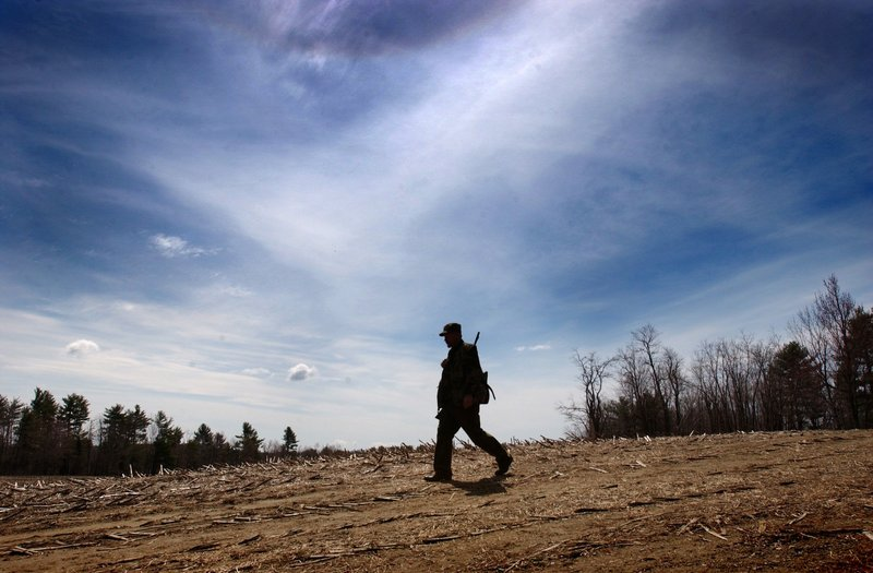 A hunter crosses a cornfield in Waldo in 2002, when nearly 41,000 nonresident hunting licenses were purchased. By 2010, that number had dropped to fewer than 28,000.