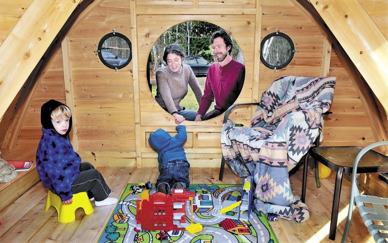 Melissa and Rocy Pillsbury watch as their children Richard, left, and Maxximus play in one of the Hobbit Hole playhouses they make for their Unity business, Wooden Wonders. The structures are variations of those described in J.R.R. Tolkien's novels.