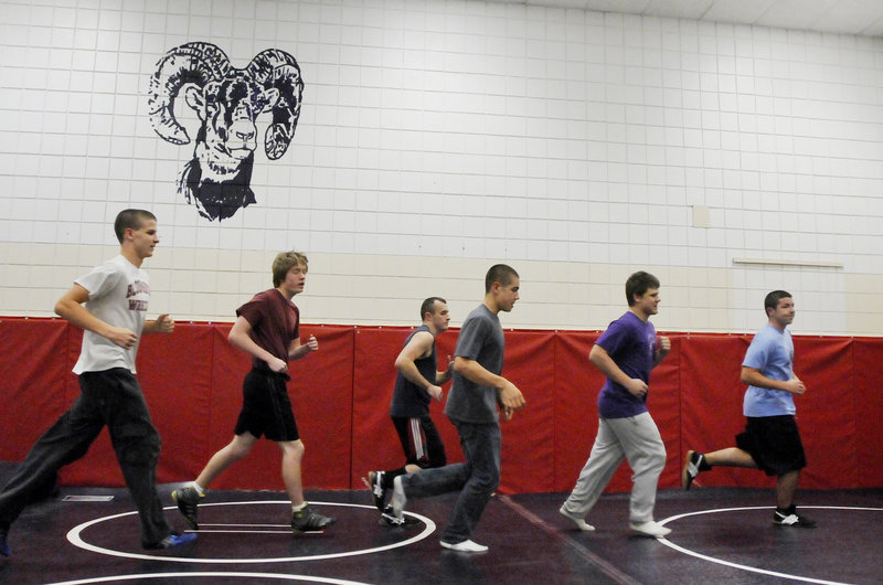 It's time for conditioning for the Deering wrestling team, which ran 2.5 miles outside on Monday before heading inside for warm-ups, drills and scrimmaging. Deering is hoping to improve on last season's 2-12 record in dual meets.