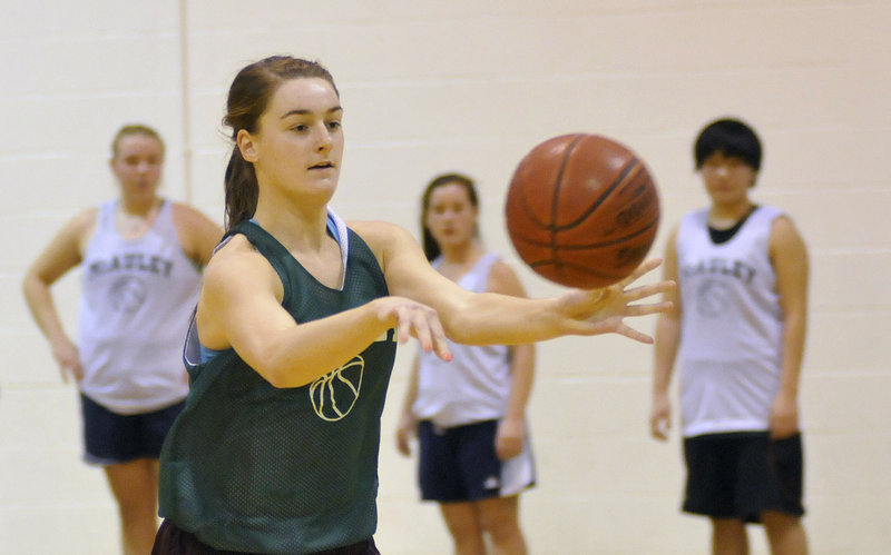 Allie Clement of McAuley passes to a teammate during Monday's first practice of the season.