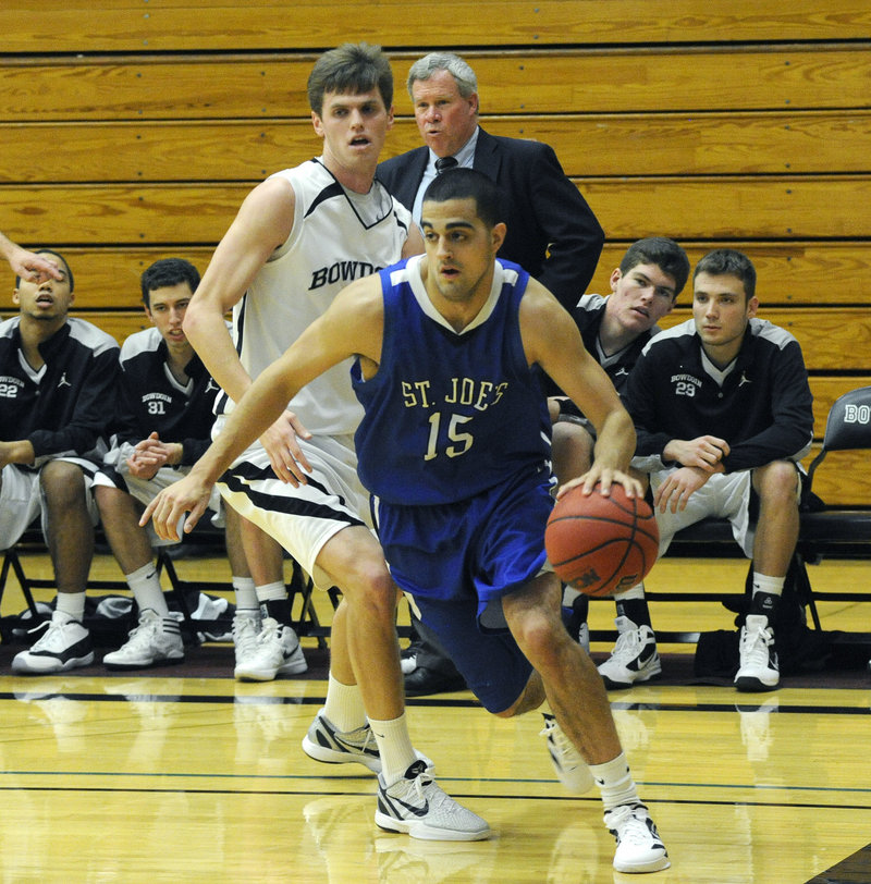 Zach O Brien of St. Joseph's looks for room along the baseline while pursued by Will Hanley of Bowdoin.