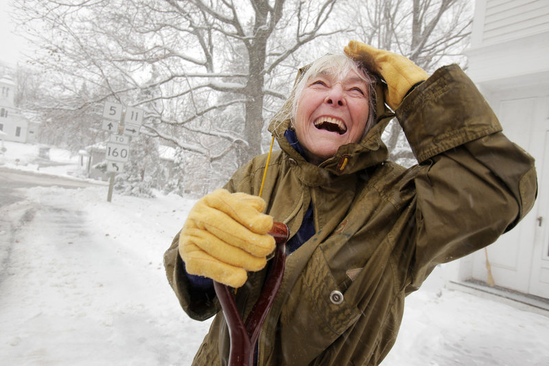 Wednesday's snowfall lifts Jane Bryant's spirits as she shovels the front of her home on Route 5 in Limerick. Bryant, 86, had a hip replacement about a year ago but that didn't stop her from taking care of the slush and snow.