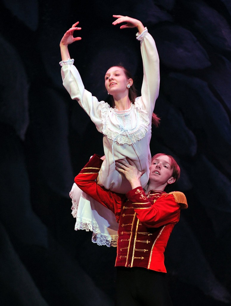 """Michael Holden, right, portraying the Nutcracker Prince, lifts Elise Bickford, portraying Clara, during a rehearsal of """"The Nutcracker."""" Both are students at Falmouth High School."""
