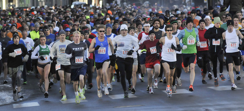 The temperatures were low, but the enthusiasm was high Thursday for the start of the Thanksgiving Day 4-mile road race that wound through downtown Portland.