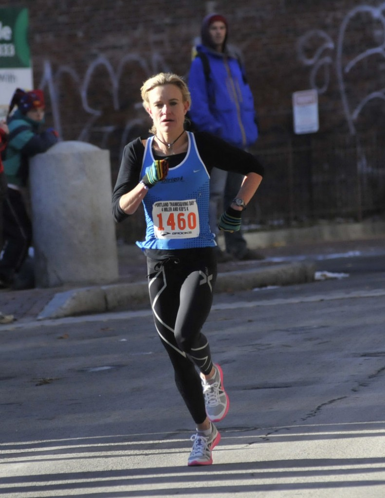 Kristin Barry of Scarborough, training for the Olympic marathon trials, won the women's division in Portland.