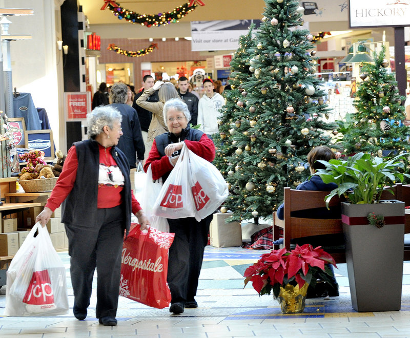 Sisters Connie Donoghue of Sabattus and Jackie Gahagan of Lewiston, who have been shopping together at the Maine Mall for 30 years, join other Black Friday shoppers at the retail mecca, which opened at 5 a.m. Friday. The day after Thanksgiving is typically the biggest shopping day of the year for many of the mall's anchor stores. John Patriquin/Staff Photographer