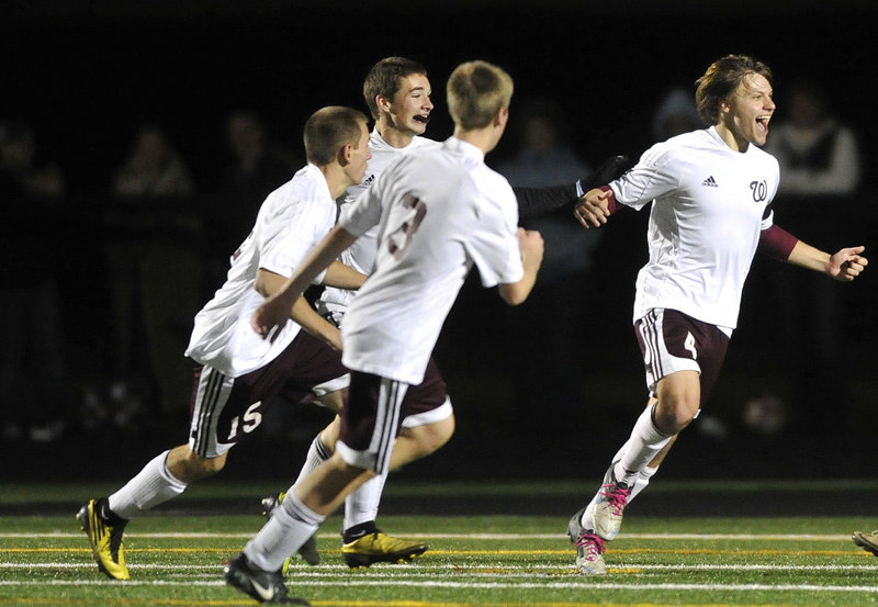 Robby Lentine, right, was the spark that helped carry Windham to its first Class A state championship and made him the MVP for boys' soccer this season.