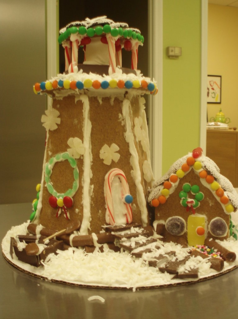 Michele Howard leads a Gingerbread lighthouse workshop where participants produce a sweet beacon like this one.