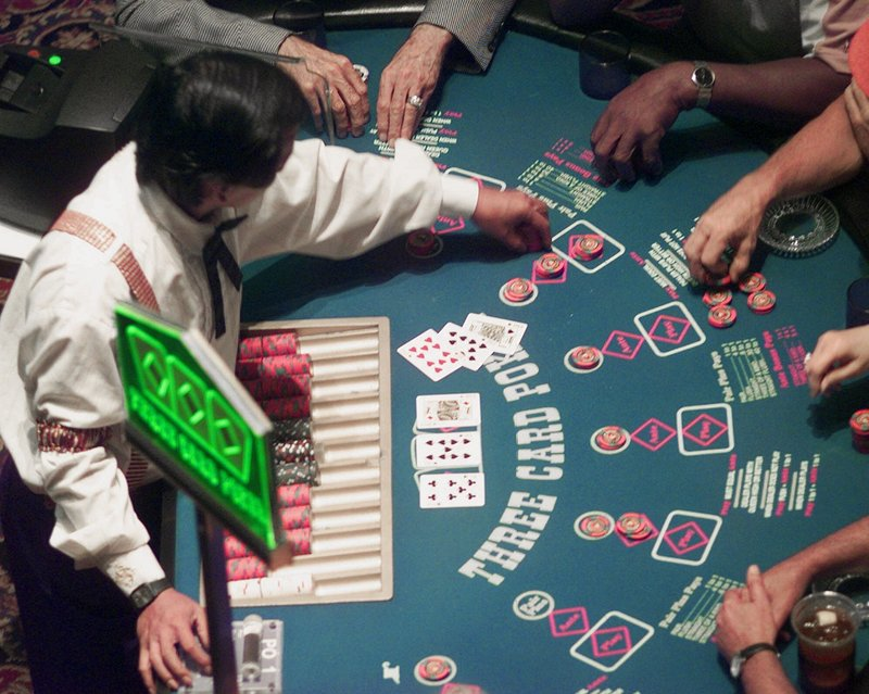 Poker players make wagers at Station Casino in Kansas City, Mo., in 1999. Gamblers will soon be able to place their bets on blackjack, craps and other table games in Maine when Hollywood Slots in Bangor adds 14 table games next spring. A casino under construction in Oxford also plans to have games when it opens in June.