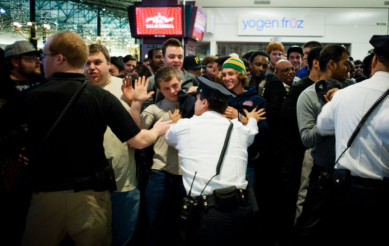 Crowds of Black Friday shoppers try to push through security staff moments after the doors opened outside Best Buy at the Mall of America in Bloomington, Minn. Best Buy was among the retailers that opened at midnight Thursday.