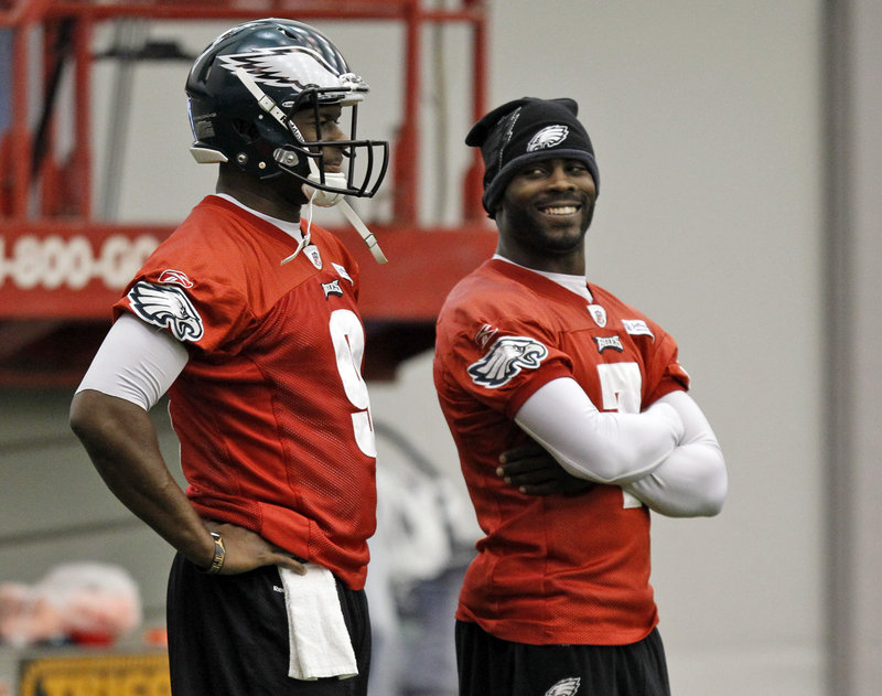 Regardless of whether Vince Young, left, or Michael Vick, right, is taking snaps for the Eagles today, New England knows it must be prepared for a quarterback who is capable of making big plays with both his arms and his legs.