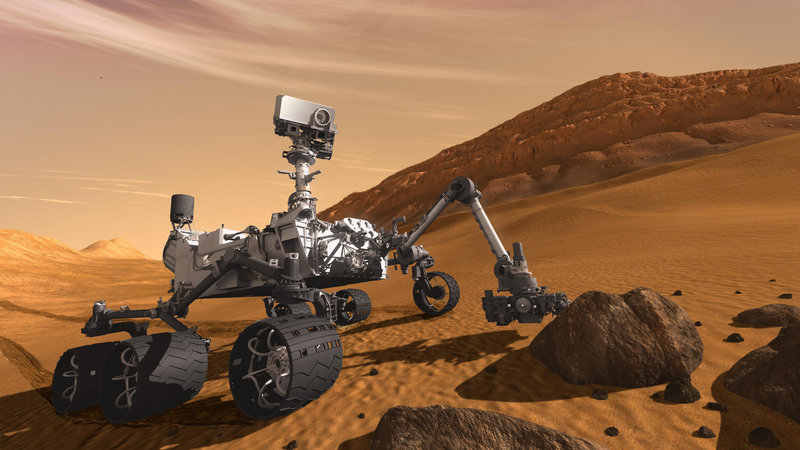 This 2011 artist's rendering depicts how the Mars Science Laboratory Curiosity rover would examine a rock on Mars. The six-wheeled mobile robot is designed to investigate Mars' past and present ability to sustain microbial life.
