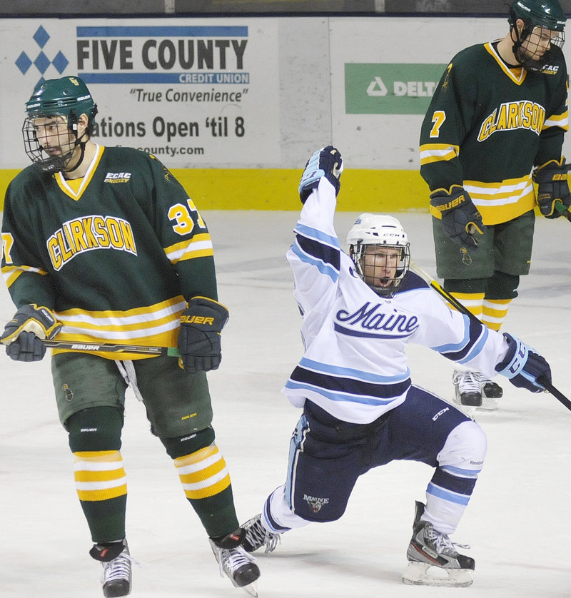 Adam Shemansky celebrates after the first of his two goals Saturday in Maine's 4-3 win over Clarkson at the Cumberland County Civic Center.