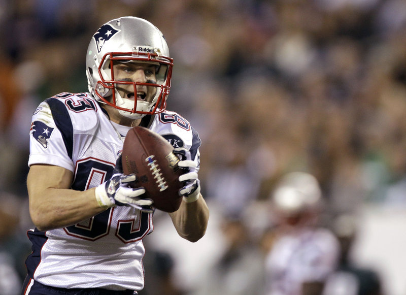 Wes Welker makes a 41-yard TD catch in the first half Sunday in the Patriots' 38-20 win over the Eagles in Philadelphia. Welker also caught a 9-yard TD pass in the third quarter and finished with eight catches for 115 yards.