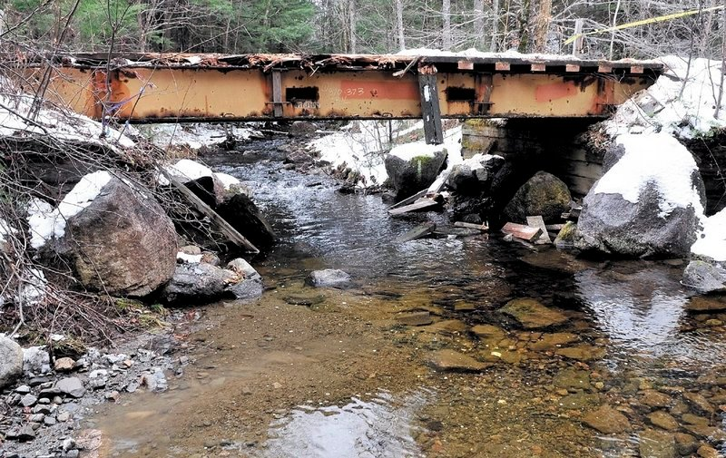 Roland Drew of Arundel died late Friday when his truck plunged off the side of this wooden snowmobile bridge.