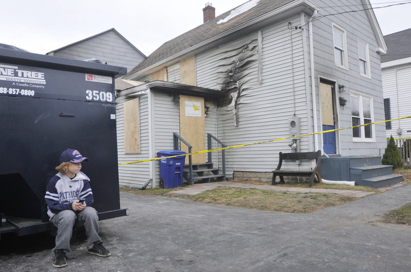 """Not a good weekend,"" said Max Calkins, 10, sitting in front of his burned-out home in South Portland."