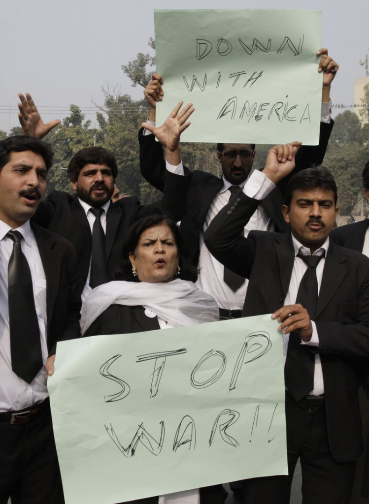 Pakistani lawyers condemn NATO airstrikes on Pakistani border posts, at a protest in in Lahore, Pakistan, on Monday.