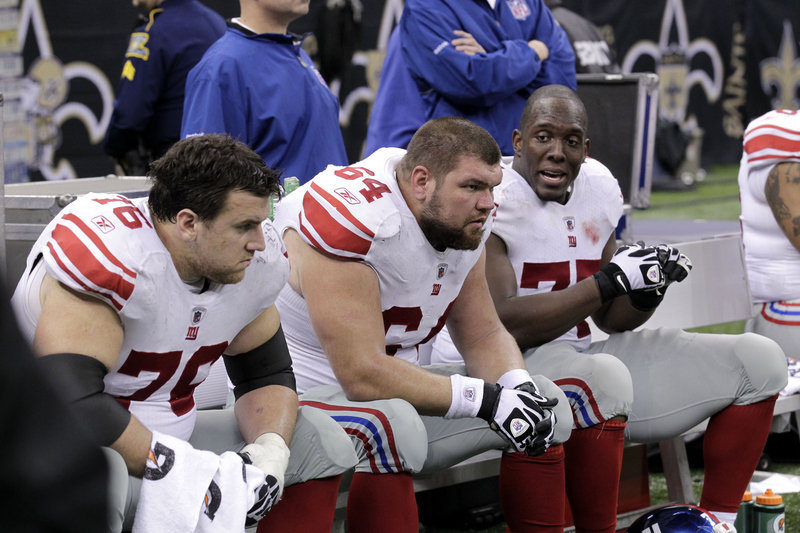 New York Giants center David Baas, 64, and teammates are not pleased during the fourth quarter of their 49-24 loss Monday night to the New Orleans Saints. The Giants, who have lost three straight, are a game behind the Dallas Cowboys in the NFC East and face Green Bay on Sunday.