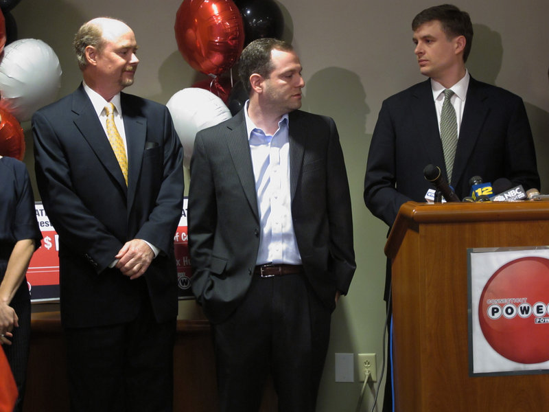 From left, Tim Davidson, Brandon Lacoff and Greg Skidmore, three asset managers from Greenwich, Conn., claim a $254 million Powerball prize on Monday at Connecticut Lottery headquarters in Rocky Hill, Conn.