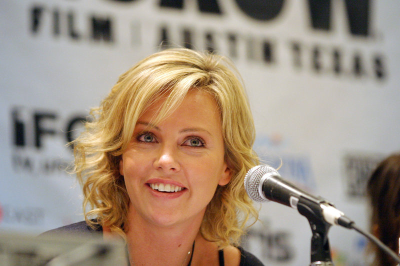 """Actress Charlize Theron, the mean queen in """"Snow White and the Huntsman,"""" says she was bullied in school, wore """"really nerdy glasses"""" and didn't have a lot of boyfriends."""