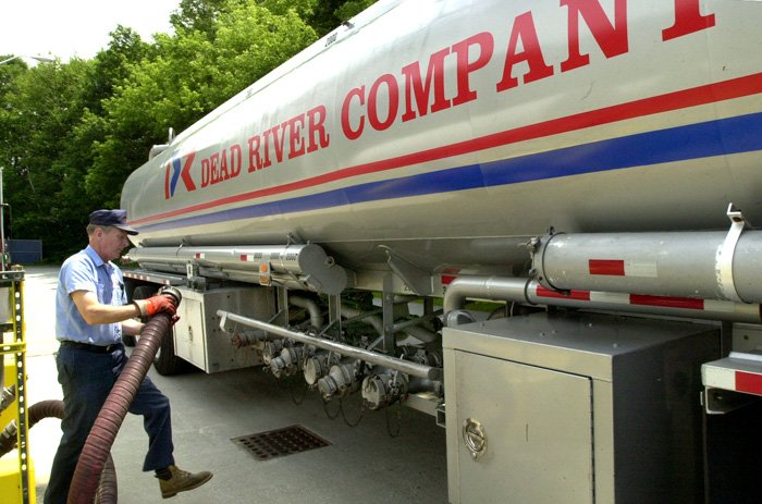 A Dead River Company employee unloads heating fuel at the Dead River terminal in Auburn.