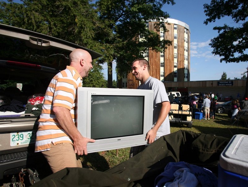 Bert Holmberg, left, and his son Karl of Newton, N.H., unload a trailer as they move family member Jillian into Dickey-Wood Hall at the University of Southern Maine in Gorham in 2010. With the attractions of Maine at its disposal and the demand for higher education high, the university should be able to fill its classes with out-of-state and foreign students, who would pay higher non-resident tuition and support valuable programs.