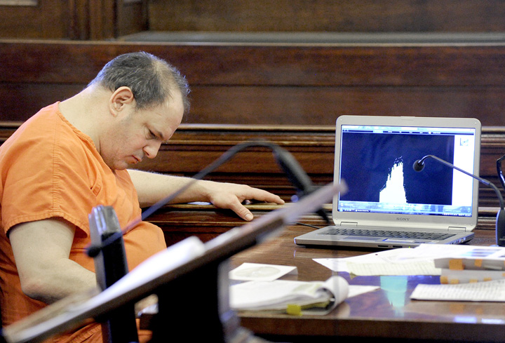 Steven Ricci listens to a recording of his victim's call to the Portland police, during his trial in Cumberland County Court today.