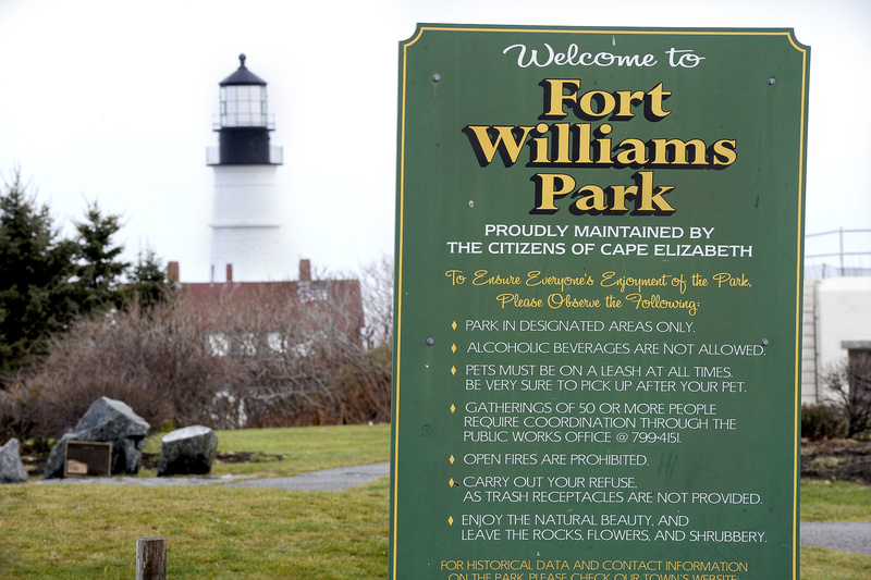 Signs specifying a drinking ban are displayed inside Fort Williams Park. Beer will be sold during a state troopers' picnic at the park in 2012; the town picnic permit includes strict conditions.