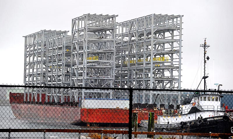 Gordon Chibroski / Staff Photographer. Wednesday, Dec. 7, 2011. This eight-story-tall metal structure aboard a barge is part of a processing plant headed to Newfoundland. It came to Portland to avoid rough weather at sea.