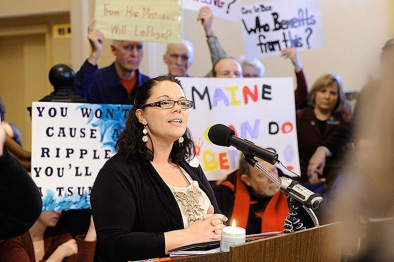 John Patriquin/Staff Photographer. Wed., Dec.14, 2011. Lewiston parent Shanna Rogers speaks during s rally in the Hall of Flags at the State House in Augusta against cuts in health care. Hundreds of Mainers are protesting and testifying against the cuts