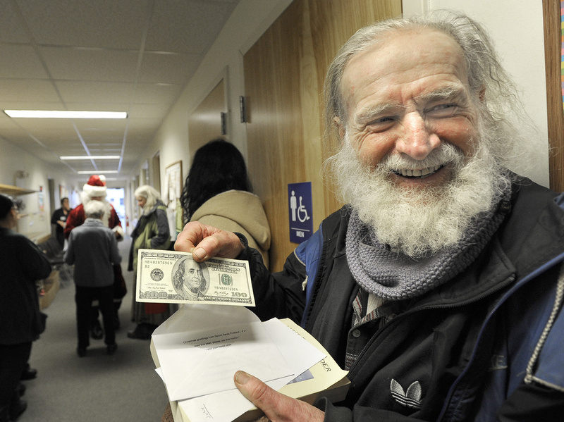 """I'm a rich man,"" said Sean Donovan of Woolwich after an assistant for Portland's Secret Santa handed him a $100 bill Wednesday at the Mid Coast Hunger Prevention Program in Brunswick. In all, Santa planned to give away $20,000 in cash gifts in four Maine cities this week."