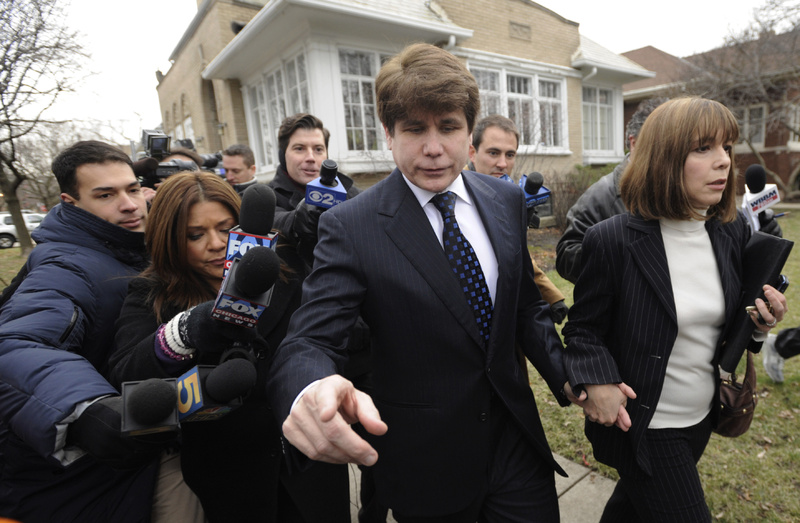 Former Gov. Rod Blagojevich, D-Ill., and his wife, Patti, leave their home for his sentencing hearing in Chicago on Tuesday. ROD BLAGOJEVICH PATTI BLAGOJEVICH